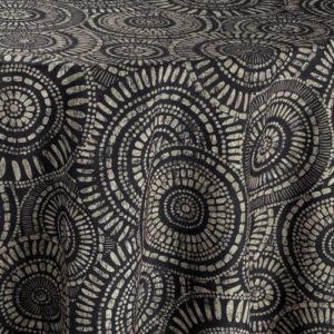 Black fabric with circular, tribal geometric pattern