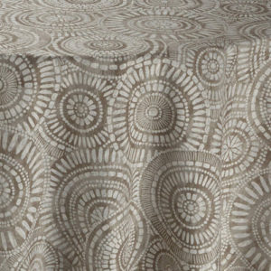 Brown fabric with circular, tribal geometric pattern